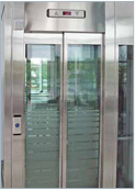 Panoramic landing door with shatterproof glass panels in a stainless-steel frame